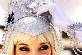 Katalin Gabriel dresses up as a showgirl during a protest against the closing of the Liberace Museum in front of the museum in Las Vegas Wednesday, September 22, 2010. Gabirel used to work in Wes Winters' show at the museum.