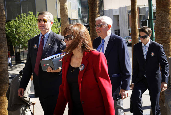 Bill Scott, left, Erik Scott's father, and others arrive for a coroner's inquest at the Regional Justice Center September 22, 2010. Scott's younger brother Kevin is at far right.