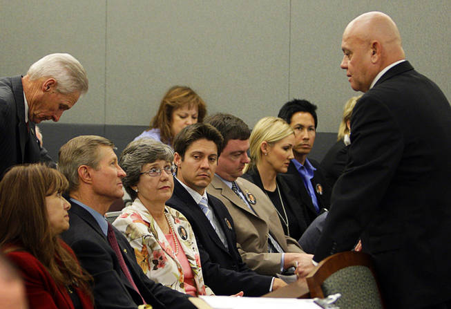 Members of the Scott family, father Bill, mother Linda, and younger brother Kevin, listen to Clark County Coroner Mike Murphy before a coroner's inquest at the Regional Justice Center September 22, 2010.