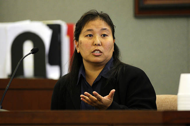 Jody Okawaki, a special agent with the U.S. Secret Service, testifies during a coroner's inquest at the Regional Justice Center Thursday, September 23, 2010.
