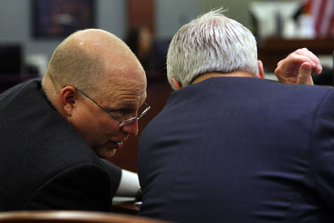 Chief Deputy District Attorney Christopher Laurent, left, confers with Assistant District Attorney Chris Owens during a coroner's inquest for Erik Scott at the Regional Justice Center Friday, September 24, 2010.