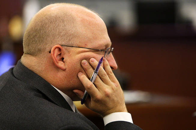 Chief Deputy District Attorney Christopher Laurent listens as a recorded interview with Erik Scott's girlfriend, Samantha Sterner, is played during a coroner's inquest for Erik Scott at the Regional Justice Center Friday, September 24, 2010.