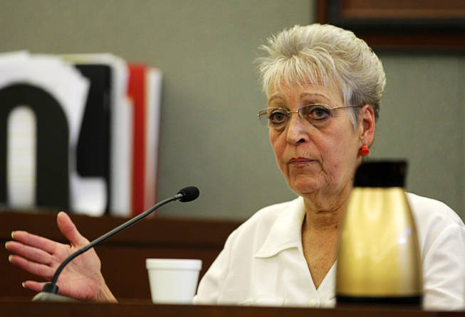 Linda Bem, the Costco employee who helped Scott sign up for a Costco membership, testifies during a coroner's inquest for Erik Scott at the Regional Justice Center Friday, September 24, 2010. Bem said Scott had a hard time understanding her instructions and filling out the forms.