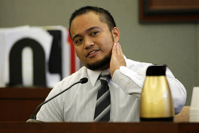 Jerome Dwight Arcano, a Costco employee, testifies during a coroner's inquest for Erik Scott at the Regional Justice Center Friday, September 24, 2010. Arcano said he thought Scott might be on drugs.
