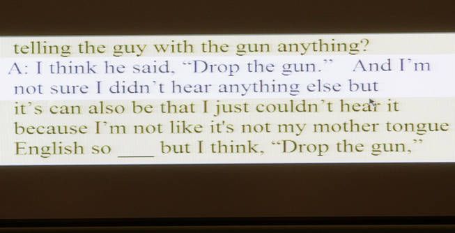 A portion of a transcript from a recorded interview with Lisa Holzgruber, a foreign exchange student, is displayed during a coroner's inquest for Erik Scott at the Regional Justice Center Friday, September 24, 2010.