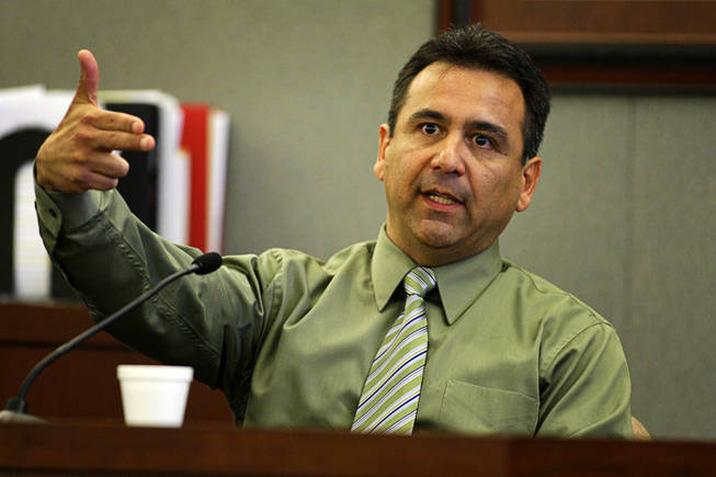 Costco assistant manager Vince Lopez testifies during a coroner's inquest for Erik Scott at the Regional Justice Center Friday, September 24, 2010. Lopez said Scott made what he perceived as a threatening gesture.