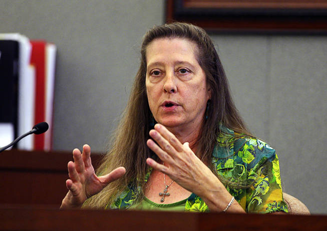 Arlene Houghton, a Costco cashier, testifies during a coroner's inquest for Erik Scott at the Regional Justice Center Friday, September 24, 2010.