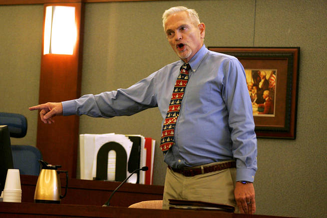 John Cooper testifies during a coroner's inquest for Erik Scott at the Regional Justice Center Saturday, September 25, 2010.