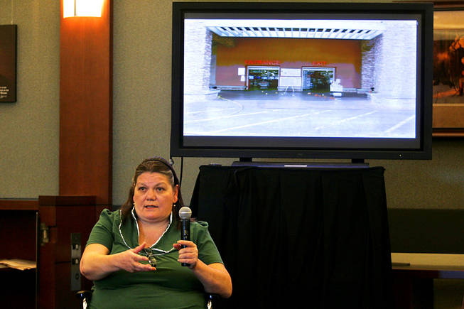 Costco shopper Dolly Rand testifies during a coroner's inquest for Erik Scott at the Regional Justice Center Saturday, September 25, 2010.