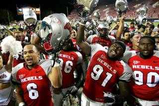 UNLV football players sing the UNLV fight song after defeating New Mexico 45-10 in their Mountain West Conference game Saturday, September 25, 2010. From left are Mike Clausen, James Dunlap, Preston Brooks and Isaiah Shivers.