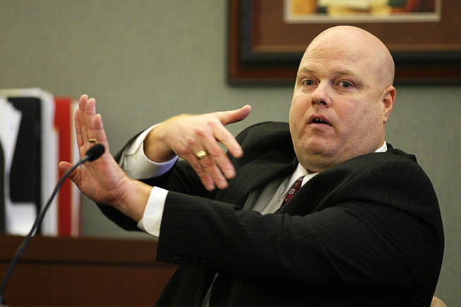 Costco employee Clayton Phillips testifies during a coroner's inquest for Erik Scott at the Regional Justice Center Monday, September 27, 2010.