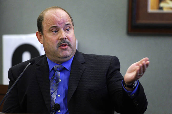 Metro Police Detective Barry Jensen testifies during a coroner's inquest for Erik Scott at the Regional Justice Center Tuesday, September 28, 2010.