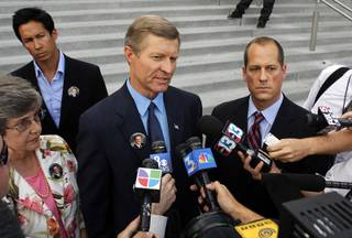 Bill Scott, center, father of Erik Scott, speaks to reporters after a coroner's inquest for Erik Scott at the Regional Justice Center Tuesday, September 28, 2010. With Bill Scott are his wife Linda and attorney Ross Goodman. The jury found that the shooting of Erik Scott was justified.
