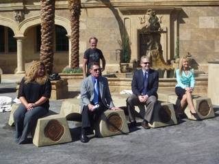 Clark County Liaison Tiffany Hesser, North Las Vegas Councilman Richard Cherchio, Las Vegas Sustainability Officer Thomas Perrigo and Henderson Councilwoman Kathleen Boutin test the park benches made of