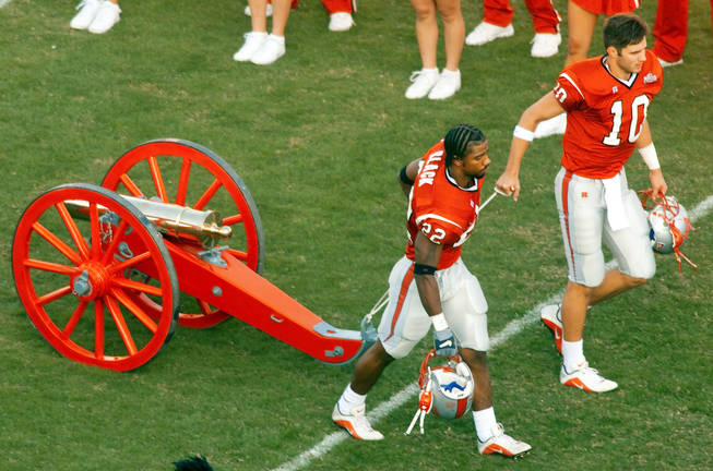 UNLV players roll out the refurbished Fremont Cannon two weeks after beating UNR in 2000. Fans broke the cannon in the post-game celebration that year, but the UNLV athletics department repaired it in time for the Rebels next home game against Wyoming.