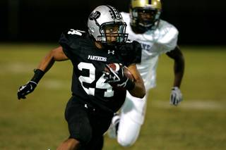 Palo Verde running back Ryan Beaulieu turns upfield against Cheyenne. Palo Verde won the game 49-0.