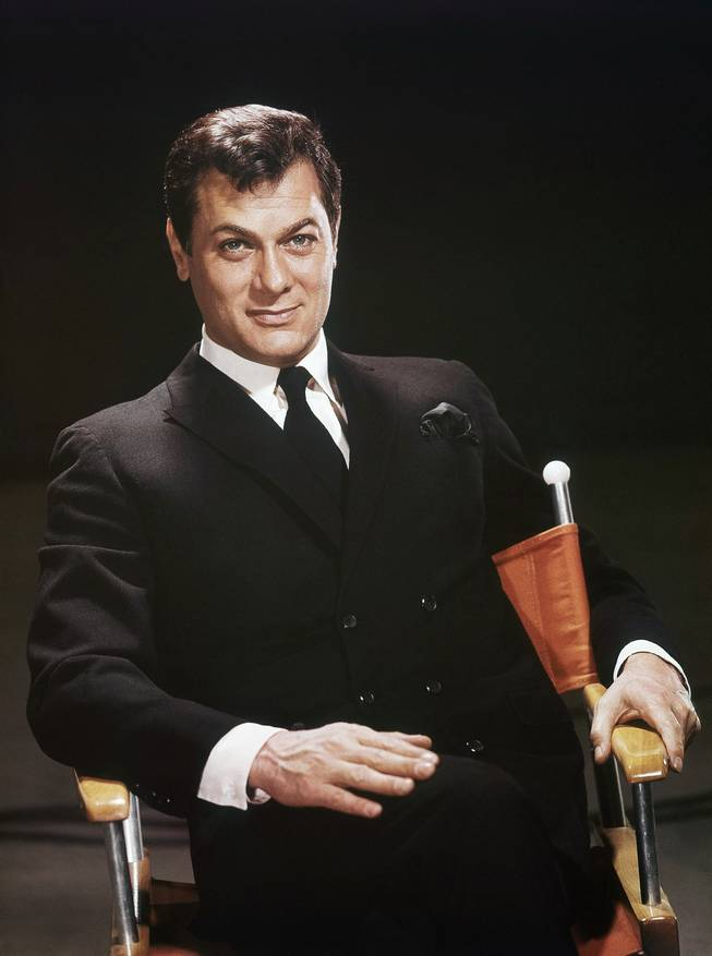 Actor Tony Curtis is shown seated in a studio chair, 1965 file photo. Curtis died Wednesday Sept. 29, 2010, at his Henderson home of a cardiac arrest at 85, according to the Clark County coroner.