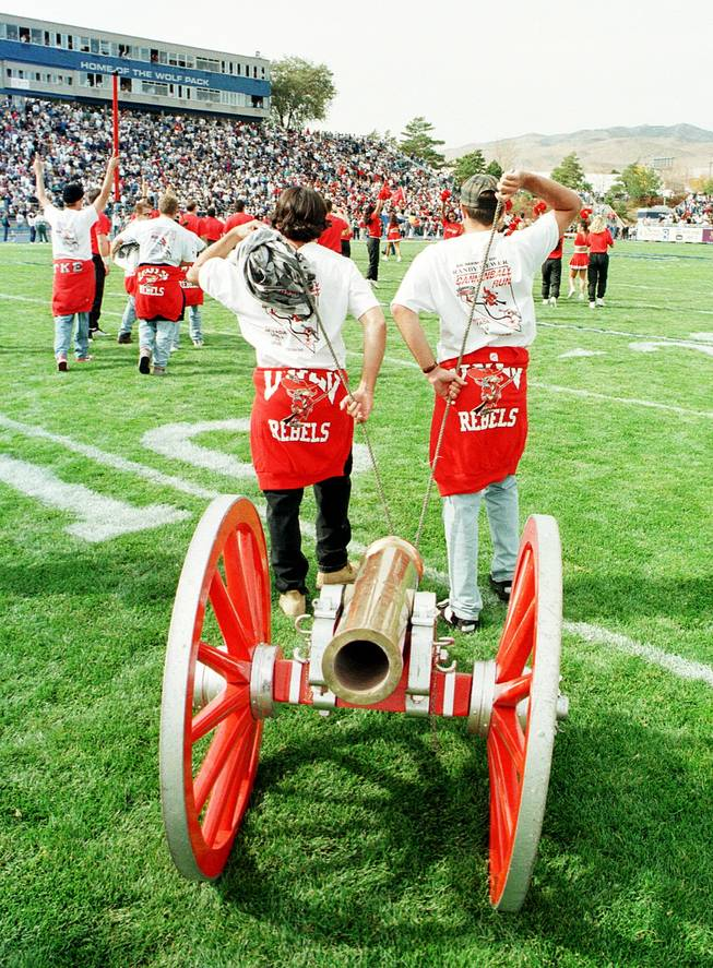 UNLV students pull the Fremont Cannon onto the field at UNR on Oct. 28, 1995, after UNR regained possession of the cannon in a 55-32 win. Pre- and post-game incidents marred the contest.