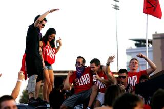 UNLV fans tailgate before Saturday's football game against UNR.