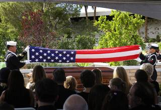 Members of a U.S. Navy honor guard fold the flag that covered the casket of Tony Curtis during the funeral for the actor at Palm Mortuary and Cemetery in Henderson October 4, 2010. Curtis died Wednesday at his home. He was 85-years-old.