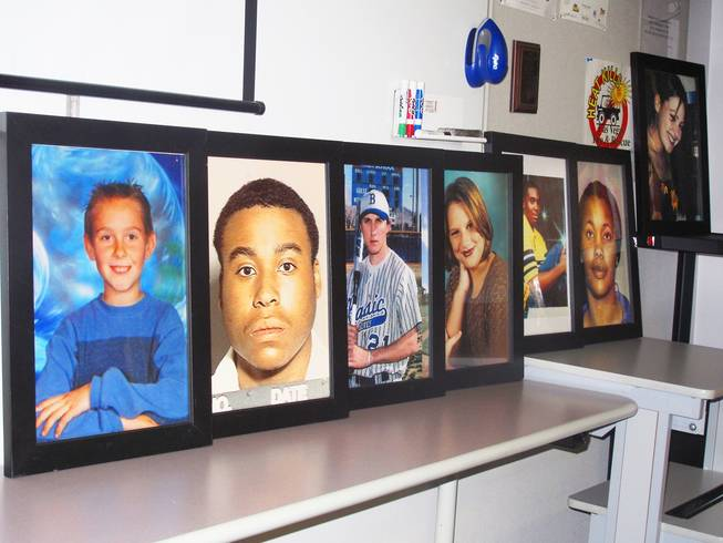 "Instructors tell stories of local teenagers, pictured in a row, who died as a result of violent or reckless behavior. ""This is where their heads are finally open, and we can put something in it,"" says Jerry Simon, gang specialist."