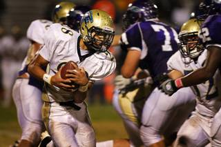 Foothill High School's Miles Killebrew (28) carries the ball during a game at Silverado Friday, October 8, 2010. Foothill won the game 13-7.