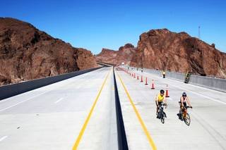 Participants in the Viva Bike Vegas event gather Saturday on the Hoover Dam bypass bridge before turning around to finish their 115-mile ride.