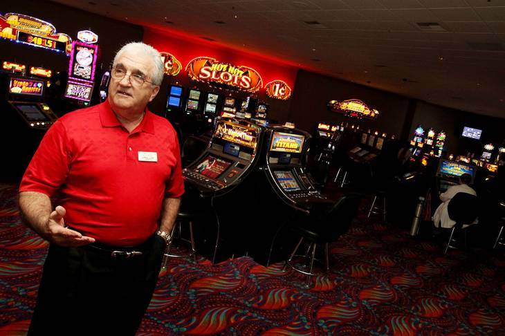Ron Lurie, general manager of Arizona Charlie's near Decatur and Charleston, shows the enclosed no-smoking area of the casino. Lurie says the $80,000 project included new carpeting, wallpaper and ceiling tiles, as well as a thorough scouring of the 117 machines.