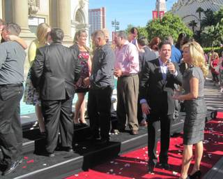 Donny Osmond, accompanied by his wife Debbie, emcees the 10:10 a.m. proposals at Caesars Palace on Oct. 10, 2010.