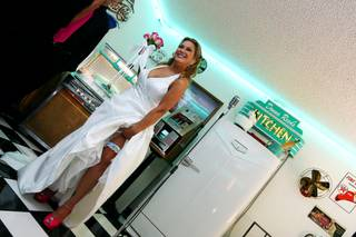 Shelli Mazzone shows off her blue garter and pink shoes before her wedding on 10/10/10 at 10 a.m. at the Viva Las Vegas Wedding Chapel.