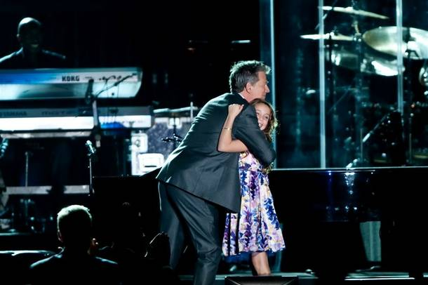 David Foster hugs Casey Glasser during the Andre Agassi Grand Slam benefit concert at the Wynn on Oct. 9, 2010.