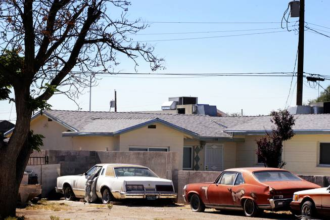 Broken down cars parked in front of a house on ...
