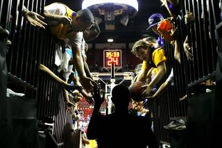 Los Angeles Lakers fans greet a player before their preseason game against the Sacramento Kings at the Thomas & Mack Center Wednesday, 13, 2010. The Lakers won the game 98-85.