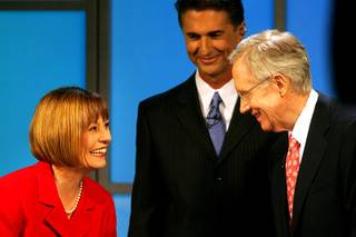 Sharron Angle and Sen. Harry Reid exchange pleasantries after their debate, moderated by Mitch Fox, center, on Thursday at the Vegas PBS studios.