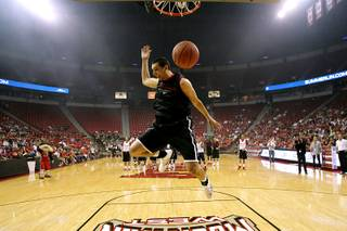 UNLV guard Karam Mashour follows through during a dunking demonstration before their First Look scrimmage Friday, October 15, 2010.