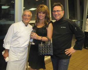 Chefs Andre Rochat and Rick Moonen flank Laura Croft at the Jean-Louis Palladin dinner at RM Seafood in Mandalay Bay on Oct. 17, 2010.