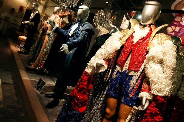Liberace's vintage clothing, donning sparkling jewels, line the walls of the Liberace Museum during its final hours of business Sunday in Las Vegas.
