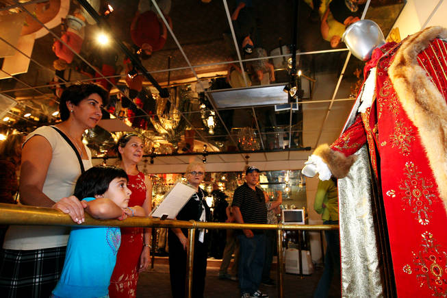Rose Matin, 5, gazes at a rhinestone-studded costume of Liberace's while visiting the Liberace Museum with her mom, Nahid, and aunt, Maggie, right, Sunday, in Las Vegas.
