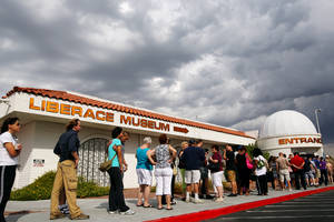 Fans wait in line to enter the Liberace Museum on its final day of business after 31 years of operation in Las Vegas, Sunday, October 17, 2010.