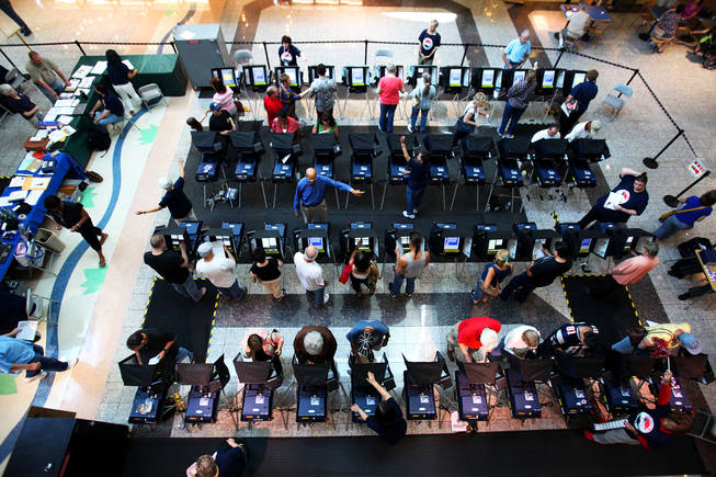 Early voters fill the Galleria at Sunset mall voting station Saturday, the first day of early voting. Whether Hispanic voters turn out to vote in large numbers could be pivotal in the race between Senate Majority Leader Harry Reid and Republican challenger Sharron Angle.
