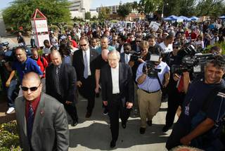 Senate Majority Leader Harry Reid, center, leads a group to an early voting polling place during a rally at UNLV Tuesday, October 19, 2010. Reid faces Republican challenger Sharron Angle in the general election.