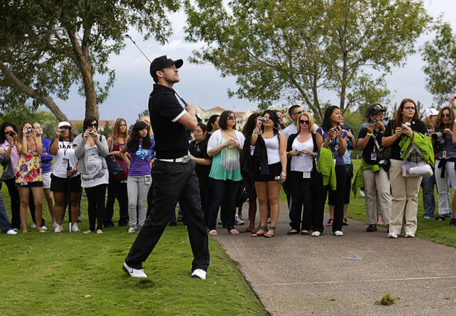 Singer and tournament host Justin Timberlake shoots from the rough during the Pro Am portion of the Justin Timberlake Shriners Hospitals for Children Open golf tournament at TPC Summerlin October 20, 2010.