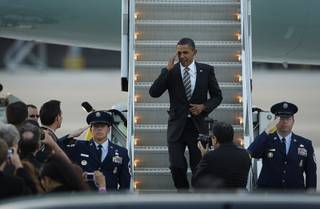 President Barack Obama salutes after landing at McCarran International Airport in Las Vegas Friday, October 22, 2010.