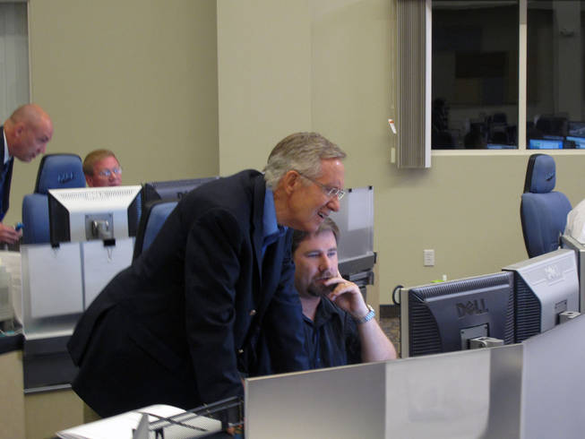 Sen. Harry Reid looks at Traffic Technician John Doran's computer screen in the Freeway and Arterial System of Transportation traffic management center on Friday, Oct. 22, after Reid participated in a press conference announcing the approval of a Record of Decision for Project Neon, which will improve Interstate 15 in Las Vegas.
