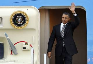President Barrack Obama waves after landing at McCarran International Airport in Las Vegas Friday, October 22, 2010. Obama will speak at a