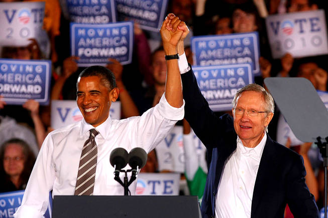 "Sen. Harry Reid introduces President Barack Obama for a speech outside Orr Middle School at a ""Moving America Forward"" rally Friday, October 22, 2010."