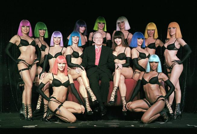 "Hugh Hefner -- that's him in the middle -- with the ""Crazy Horse Paris"" cast."