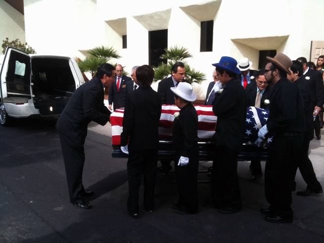 "Pallbearers prepare to place Edmundo ""Eddie"" Escobedo's casket in a hearse following a memorial service Saturday at Palm Mortuary in downtown Las Vegas."
