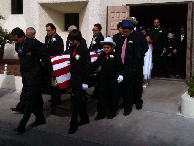 "Pallbearers bring Edmundo ""Eddie"" Escobedo's casket out of the chapel following a memorial service Saturday at Palm Mortuary in downtown Las Vegas."