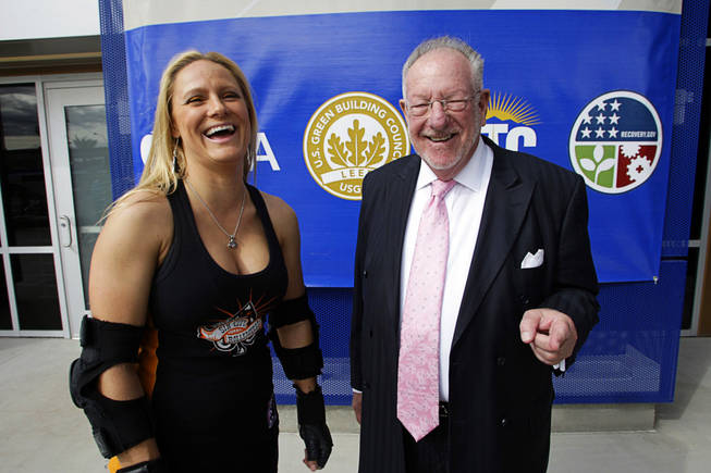 "Katie ""The Force"" Claessens of the Fabulous Sin City Rollergirls poses with Las Vegas Mayor Oscar Goodman during a ceremony marking the completion of the Bonneville Transit Center in downtown Las Vegas Monday, October 25, 2010. The Rollergirls gave Goodman a Rollergirls' nickname - ""80 Proof."" The facility will serve as the central hub for the RTC's transit services, including the Strip & Downtown Express, the Deuce on the Strip, Centennial Express, MAX and 12 other routes."